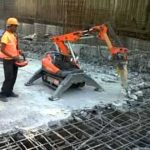 The robot eats concrete with water so the rebar can be re-used!
